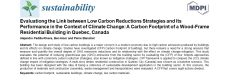 Evaluating the link between low carbon reductions strategies and its performance in the context of climate change: A carbon footprint of a qood-frame residential building in Quebec, Canada